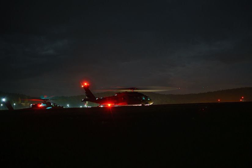 Helicopter prepare to take off at night.