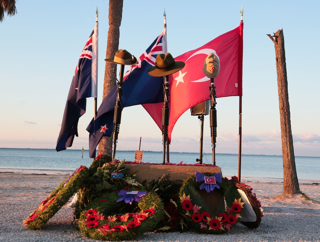 Wreaths and poppies lie below an Anzac Day memorial following a dawn service on the beach at MacDill Air Force Base, April 25. Personnel from U.S. Central Command, U.S. Special Operations Command, and other base commands attended the commemoration service that marks the anniversary of the military campaign on the Gallipoli Peninsula fought by Australian and New Zealand forces during World War I. Anzac Day also commemorates the lives lost by Australians and New Zealanders during World War II and subsequent military and peacekeeping operations. (Photo by Tom Gagnier)