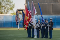 The Joint Service Color Guard presents the American Flag and the five U.S. military branch flags during the National Anthem during a Norfolk Tides game at Harbor Park, Virginia, April 21, 2018. Fort Eustis, Virginia is celebrating its 100 years and remembering the variety of missions it has supported since 1918. (U.S. Air Force photo by Senior Airman Derek Seifert)