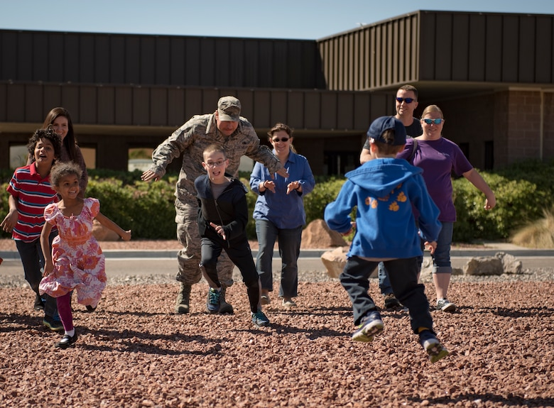 Participants play a game of tag during a Leave No Trace workshop at Nellis Air Force Base, Nevada, March 28, 2018. The game simulated how invasive species can have a negative impact on the environment. (U.S. Air Force photo by Airman 1st Class Andrew D. Sarver)