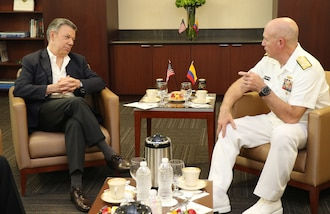 Colombian President Juan Manuel Santos and U.S. Navy Adm. Kurt W. Tidd talk during private meeting