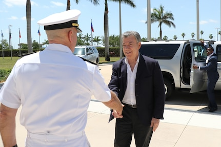 Colombian President Juan Manuel Santos and U.S. Navy Adm. Kurt W. Tidd greet each other