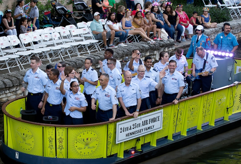 Air Forces Cyber Airmen participate in the Texas Cavaliers River Parade during 2018 Fiesta San Antonio, April 23. Fiesta San Antonio is held annually to honor those who lost their lives at the Alamo and Battle of San Jacinto. (U.S. Air Force photo by Tech. Sgt. R.J. Biermann)