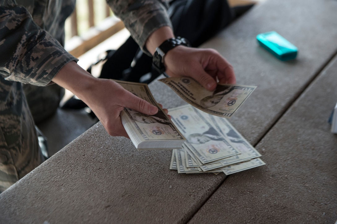 1st Lt. Elizabeth McKenna, a contracting officer for the 82nd Contracting Squadron at Goodfellow AFB, counts fake money during a contracting contingency exercise, April 17, 2018, Fort Sill, Okla. Contracting Airmen from five different bases came together to exercise Operational Contract Support in a deployed environment. (U.S. Air Force photo by Airman Jeremy Wentworth)
