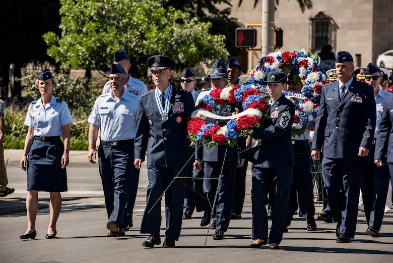 Lt. Gen. Steven Kwast, commander of Air Education and Training Command, and Chief Master Sgt. Juliet C. Gudgel, AETC command chief master sergeant, carry a wreath April 23, 2018, during the annual Pilgrimage to the Alamo in San Antonio, Texas. The Pilgrimage to the Alamo includes a march through downtown San Antonio and ends with a wreath-laying ceremony in honor of those who fought in the battles of the Alamo and San Jacinto. (U.S. Air Force photo by Senior Airman Stormy Archer)