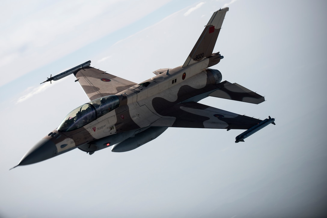 A Royal Moroccan air force F-16 flies above Morocco during Exercise African Lion April 20, 2018. Various units from the U.S. Armed Forces will conduct multilateral and stability operations training with units from the Royal Moroccan Armed Forces in the Kingdom of Morocco. This combined multilateral exercise is designed to improve interoperability and mutual understanding of each nation's tactics, techniques and procedures while demonstrating the strong bond between the nation's militaries. (U.S. Air Force photo/Senior Airman Malcolm Mayfield)