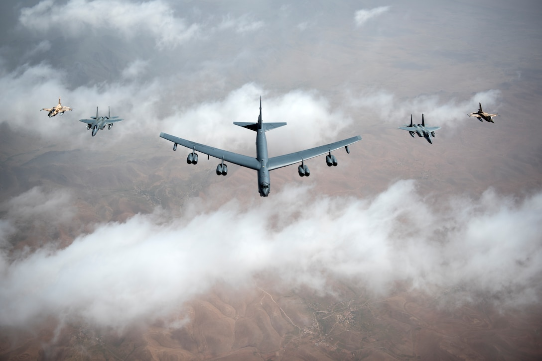 U.S. Air Force F-15Cs, a B-52 Stratofortress bomber and Royal Moroccan air force F-16s fly in a formation during Exercise African Lion April 20, 2018. Various units from the U.S. Armed Forces will conduct multilateral and stability operations training with units from the Royal Moroccan Armed Forces in the Kingdom of Morocco. This combined multilateral exercise is designed to improve interoperability and mutual understanding of each nation's tactics, techniques and procedures while demonstrating the strong bond between the nation's militaries. (U.S. Air Force photo/Senior Airman Malcolm Mayfield)