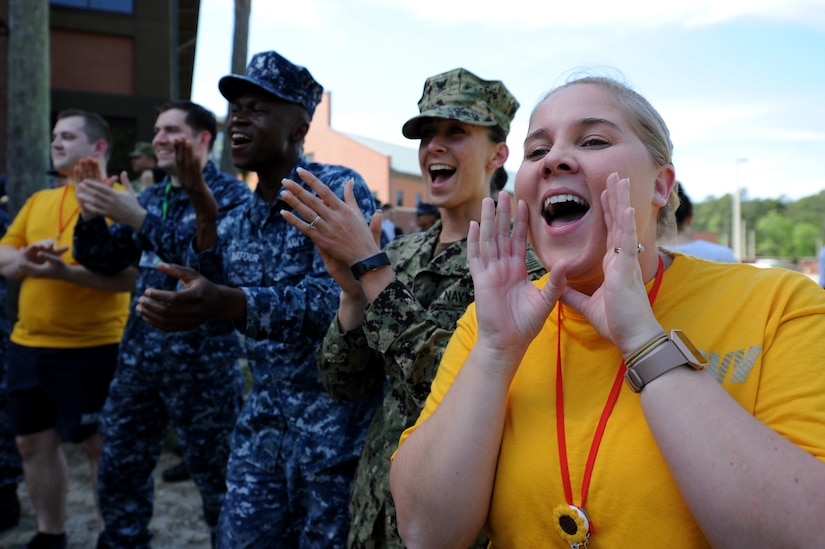 Navy Lt. Samantha Jean Reyes, right, and fellow sailors from Navel Health Clinic Charleston cheer on their follow service members during the 3rd Annual Lowcountry Skills Expo here, April 18, 2018.