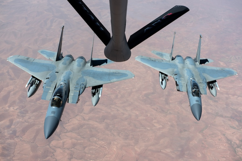 Two F-15C Eagles assigned to the 493rd Fighter Squadron prepare to receive fuel from a KC-135 Stratotanker from the 191st Air Refueling Squadron, during Exercise African Lion April 20, 2018. Various units from the U.S. Armed Forces will conduct multilateral and stability operations training with units from the Royal Moroccan Armed Forces in the Kingdom of Morocco. This combined multilateral exercise is designed to improve interoperability and mutual understanding of each nation's tactics, techniques and procedures while demonstrating the strong bond between the nation's militaries. (U.S. Air Force photo/Senior Airman Malcolm Mayfield)