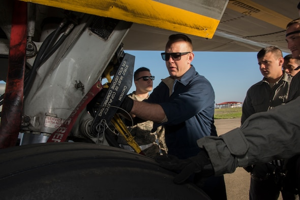 Tech. Sgt. Adam Branam, an instructor for the 373rd Training Squadron, Detachment 14 conducts a repair demonstration for a group of crew chief trainees on a KC-10 Extender wheel assembly, Feb. 7, 2018, Travis Air Force Base, Calif. The 373rd Training Squadron, Detachment 14, based out of Sheppard Air Force Base, Texas, trains crew chiefs, electricians, jet mechanics, avionics, air and ground equipment and hydraulics troops on aircraft maintenance and repair. (U.S. Air Force Photo by Heide Couch)