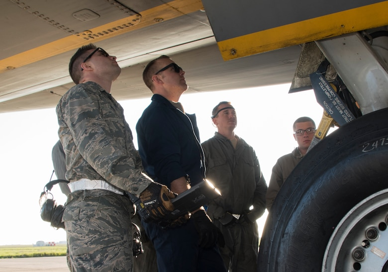 Tech. Sgt. Adam Branam, center, an instructor for the 373rd Training Squadron, Detachment 14 conducts a repair demonstration for a group of crew chief trainees on a KC-10 Extender wheel assembly, Feb. 7, 2018, Travis Air Force Base, Calif. The 373rd Training Squadron, Detachment 14, based out of Sheppard Air Force Base, Texas, trains crew chiefs, electricians, jet mechanics, avionics, air and ground equipment and hydraulics troops on aircraft maintenance and repair.  (U.S. Air Force Photo by Heide Couch)