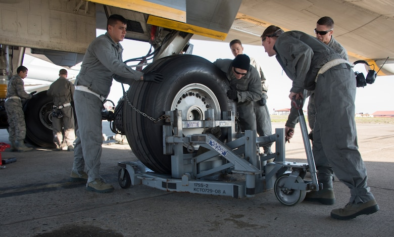U.S. Air Force crew chief trainees change a tire on a KC-10 Extender, Feb. 7, 2018, Travis Air Force Base, Calif. The 373rd Training Squadron, Detachment 14, based out of Sheppard Air Force Base, Texas, trains crew chiefs, electricians, jet mechanics, avionics, air and ground equipment and hydraulics troops on aircraft maintenance and repair.  (U.S. Air Force Photo by Heide Couch)