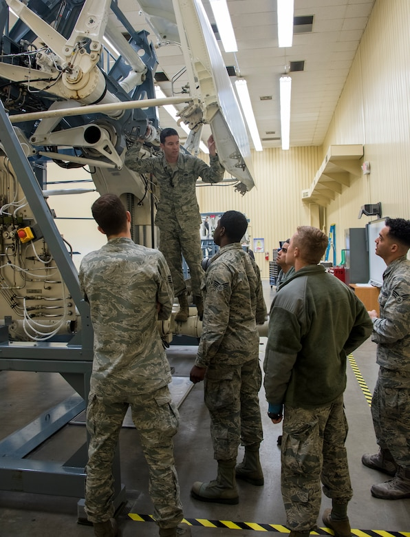 U.S. Air Force Staff Sgt. David Fagan, C-5M airframe power plant general instructor, conducts a C-5M Enroute Class on a C-5 brake simulator, April 18, 2018, Travis Air Force Base, Calif. This class for maintainers that are transferring to the C-5 M from another airframe. (U.S. Air Force Photo by Heide Couch)