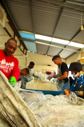 Marines sort plastic bottles during a volunteer event April 23 at the nonprofit organization Houjin Angel Kobo in Okinawa City, Okinawa, Japan. The nonprofit organization collects too many bottles to be sorted in a timely manner. Marines assisted by removing the lids and labels to be sent to the recycling center. (U.S. Marine photo by Pfc. Nicole Rogge)