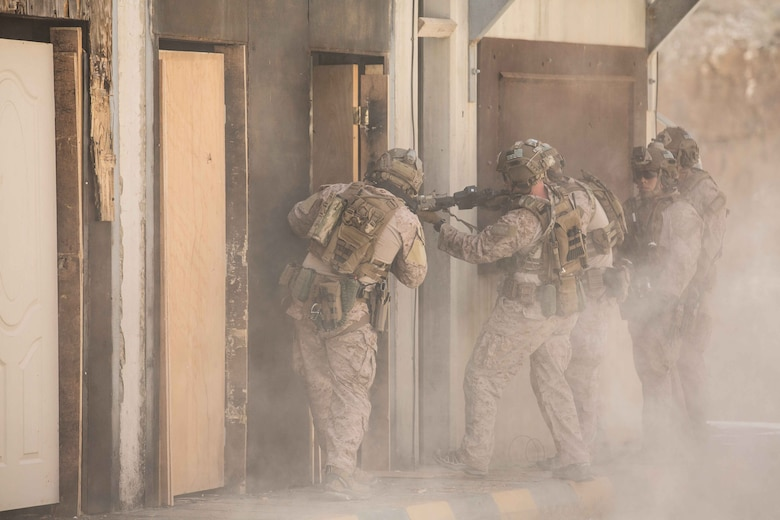 U.S. Marines assigned to the Maritime Raid Force (MRF), 26th Marine Expeditionary Unit (MEU), prepare to clear a room after breaching a door during Eager Lion at the King Abdullah II Special Operations Training Center, Amman, Jordan, April 18, 2018.
