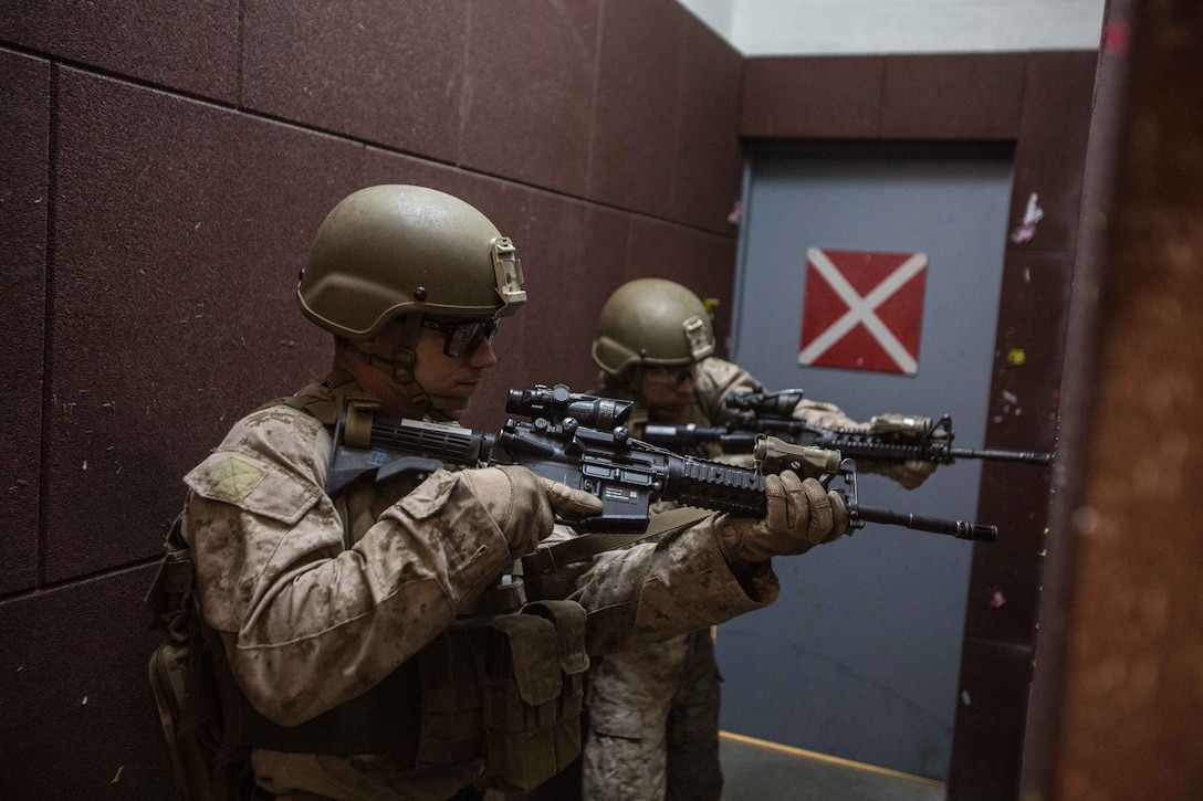 U.S. Marines assigned to the Maritime Raid Force (MRF), 26th Marine Expeditionary Unit (MEU), provide security on an entrance prior to entering during close quarters battle training as part of Eager Lion at the King Abdullah II Special Operations Training Center, Amman, Jordan, April 20, 2018.