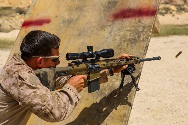 A U.S. Marine assigned to Scout Sniper Platoon, Weapons Company, Battalion Landing Team, 2nd Battalion, 6th Marine Regiment (BLT 2/6), 26th Marine Expeditionary Unit (MEU), fires at targets during a barricade shooting exercise as part of Eager Lion at the King Abdullah II Special Operations Training Center, Amman, Jordan, April 18, 2018.