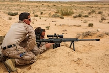 A U.S. Marine assigned to Scout Sniper Platoon, Weapons Company, Battalion Landing Team, 2nd Battalion, 6th Marine Regiment (BLT 2/6), 26th Marine Expeditionary Unit (MEU), gives guidance to another Marine during a shooting exercise as part of Eager Lion in Jordan, April 21, 2018.