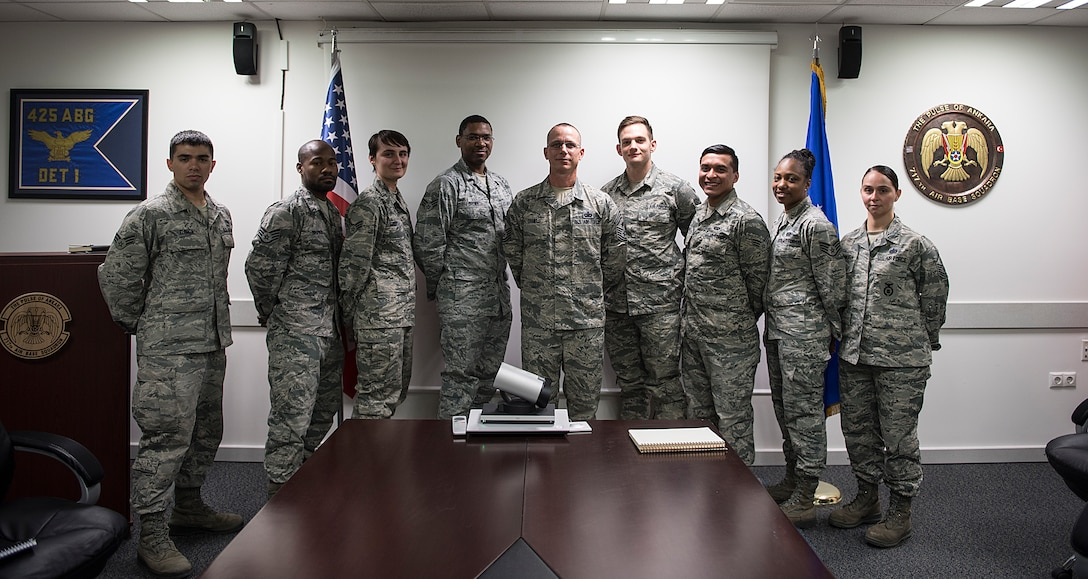 Command Chief poses for group photo with squadron