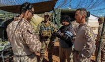 JORDAN (April 23, 2018) U.S. Marine Corps 1st Lt. Melero (left), training officer assigned to Battalion Landing Team, 2nd Battalion, 6th Marine Regiment (BLT 2/6), 26th Marine Expeditionary Unit, discusses training goals and capabilities with Jordanian soldiers with the 91st Battalion, Quick Reaction Force, Jordanian Armed Forces during the bilateral fire support coordination exercise (FSCEX), during exercise Eager Lion in Al Quwayrah, Jordan, April 23, 2018.