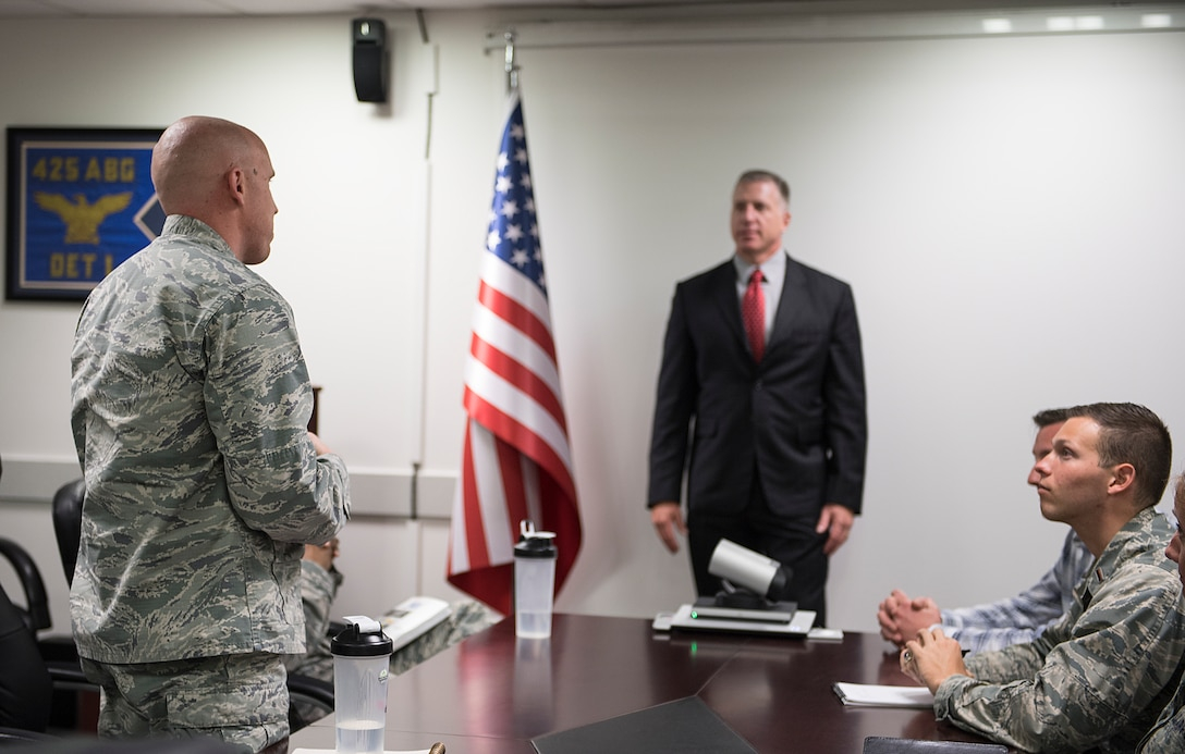 Chaplain asks question to Air Base Wing Commander during Commander's Call