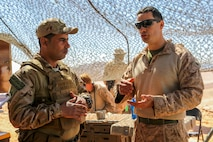 JORDAN (April 23, 2018) U.S. Marine Corps 1st Lt. Melero (right), training officer assigned to Battalion Landing Team, 2nd Battalion, 6th Marine Regiment (BLT 2/6), 26th Marine Expeditionary Unit, discusses training goals and capabilities with a Jordanian soldier assigned to the 91st Battalion, Quick Reaction Force, Jordanian Armed Forces during the bilateral fire support coordination exercise (FSCEX), during exercise Eager Lion in Al Quwayrah, Jordan, April 23, 2018.