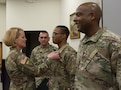 Col. Kathleen Porter, commander of the 83rd U.S. Army Reserve Readiness Training Center, 100th Training Division commander, awards Staff Sgt. Paris Bledsoe, 5th Brigade Health Services, 94th Training Division – Force Sustainment, for competing in the 80th Training Command's Best Warrior Competition and winning his division's top honors during the competition's awards ceremony. (U.S. Army Reserve photo by Maj. Addie Leonhardt, 80th Training Command)