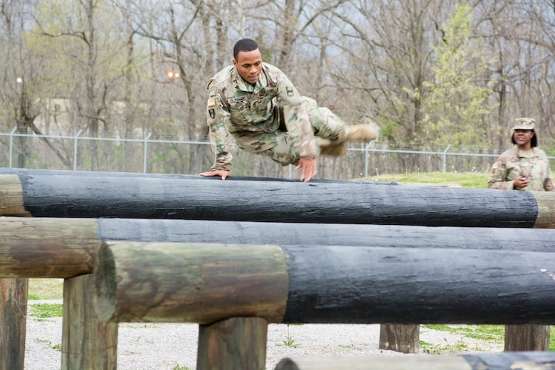 Staff Sgt. Paris Bledsoe, assigned to the 5th Brigade Health Services, 94th Training Division – Force Sustainment, jumps over multiple raised logs in the obstacle course portion of the 80th Training Command's 2018 Best Warrior Competition at Fort Knox, Kentucky, April 14, 2018. (U.S. Army Reserve photo by Maj. Addie Leonhardt, 80th Training Command)