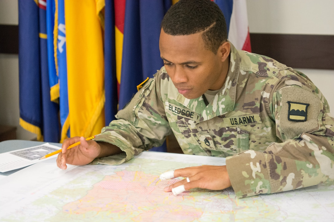 Staff Sgt. Paris Bledsoe, assigned to the 5th Brigade Health Services, 94th Training Division – Force Sustainment, works on the plotting points as part of the Army Warrior Tasks portion of the 80th Training Command's 2018 Best Warrior Competition at Fort Knox, Kentucky, April 14, 2018. (U.S. Army Reserve photo by Maj. Addie Leonhardt, 80th Training Command)