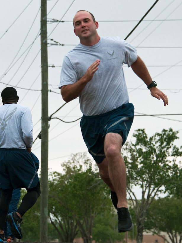 Senior AIrman Craig McMullan, 919th Special Operations Civil Engineer Squadron, appears to get airborne as he accelerates through a turn on the running track at Duke Field, Florida
