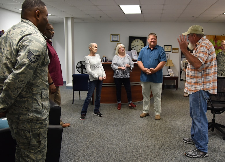Joey Roberts, Gold Star Family Member, thanks members of the 81st Force Support Squadron Airman & Family Readiness Center at the Sablich Center at Keesler Air Force Base, Mississippi, April 24, 2018. As a surviving parent of a killed in action service member, Roberts is allowed to obtain an ID card for recognition and installation access so that he can attend events and access Airmen and Family Readiness Center referral services. (U.S. Air Force photo by Kemberly Groue)