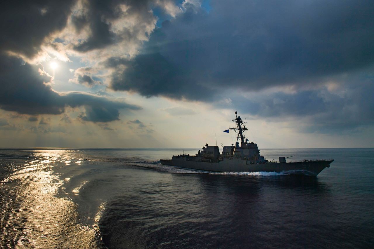 A guided-missile destroyer moves through the Indian Ocean.