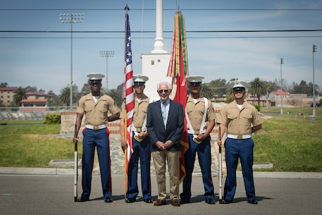 William Marks, a Vietnam veteran, poses for a photo with the 1st Marine Division color guard after a silver star presentation ceremony at Marine Corps Base Camp Pendleton, Calif., April 24, 2018.