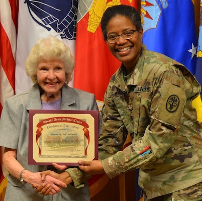 Army Col. Traci Crawford, Brooke Army Medical Center deputy commanding officer, poses for a photo with Sue McCarthy, BAMC Auxiliary Volunteer of the Year, during the BAMC Volunteer Recognition Ceremony April 16.