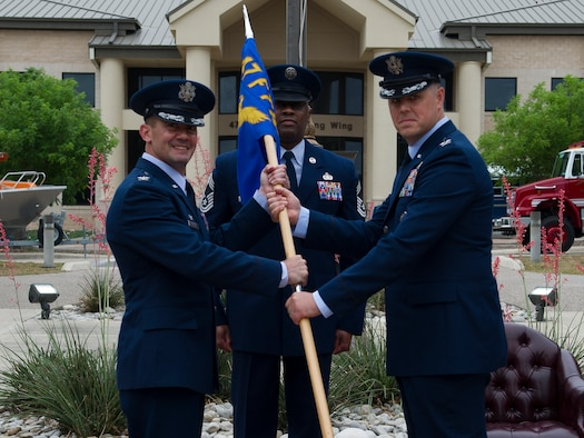 Col. Ted Glasco, 47th Mission Support Group commander, accepts the guidon at the MSG change of command ceremony at Laughlin Air Force Base, Texas, April 25, 2018. This trading of the guidon was led by Col. Charlie Velino, 47th Flying Training Wing commander.