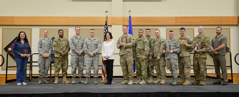 Winners of the first quarter Wing Quarterly Awards pose for a photo at the Grizzly Bend April 25, 2018, at Malmstrom Air Force Base, Mont. Pictured from left to right: Mercy Padgett, 341st Medical Group, Civilian Category II Supervisor of the Quarter; Senior Airman Audrey House, 341st Munitions Squadron, Weapons Safety Professional of the Quarter; Senior Airman Terrence Williams, 341st Security Forces Group, Airman of the Quarter; 1st Lt. Alex Palmer, 341st Mission Support Group, Company Grade Officer of the Quarter; Staff Sgt. Andrew Myers, 341st MSG, Noncommissioned Officer of the Quarter; Shannon Pea, 341st Operations Group, Civilian Category I of the Quarter; Master Sgt. Jason Shores, Tech. Sgt. Rafael Mauricio, Staff Sgt. Zackary Velasquez, Senior Airman Timothy Hennis, 341st SFG Tactical Response Force, Professional Team of the Quarter; Airman Bradley Green, 341st MDG, Volunteer of the Quarter; 741st Missile Security Forces Squadron Safety Team, Occupational Safety Professional of the Quarter; Maj. Travis Russell, 341st MDG, Field Grade Officer of the Quarter; and Nathan Mitchell, 341st MSG, Civilian Category II of the Quarter. Other winners not pictured were Airman 1st Class Camilo Barragan Barreto, 341st Logistics Readiness Squadron, Dorm Room of the Quarter; Allison Gaiser, 341st Maintenance Group, Spouse of the Quarter; Airman 1st Class Javier Rodriguez, 341st MSG, Honor Guard Member of the Quarter; Michaela Klein, 341st MSG, Civilian Category I Supervisor of the Quarter; Senior Master Sgt. Bill Allen, 341st SFG, Senior NCO of the Quarter; and 1st Lt. Hellen Edwards, 10th Missile Squadron, General Safety Professional of the Quarter. (U.S. Air Force photo by Beau Wade)