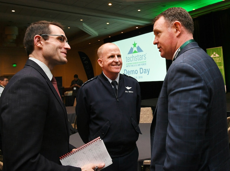 Air Force Vice Chief of Staff Gen. Stephen W. Wilson, left, and Dr. William Roper, assistant secretary of the Air Force for Acquisition, Technology and Logistics, center, discuss the April 20 TechStars Autonomous Technology Accelerator for the Air Force Demo Day at the Westin Hotel in Boston with John Beatty, right, executive director of the Massachusetts Military Force.