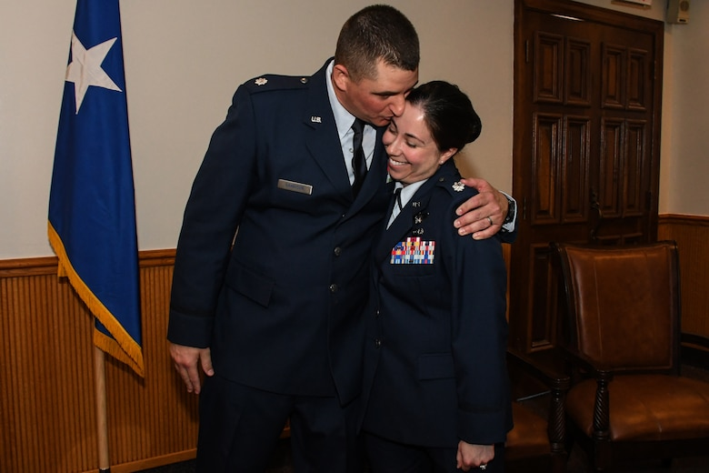 Eighth Air Force husband and wife team, Lt. Cols. Shane and Jennifer Garrison, show a little affection during a shared promotion ceremony at Barksdale Air Force Base, La., April 20, 2018.