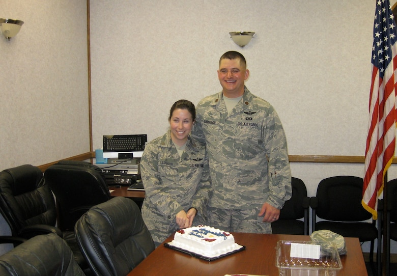 Majs. Jennifer and Shane Garrison celebrate their dual promotion with baked goods during an assignment in Germany.
