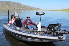 Boat Captain Daniel Moreno prepares to take Veteran John Martinez fishing at the start of the Warrior's Day on the Lake event.