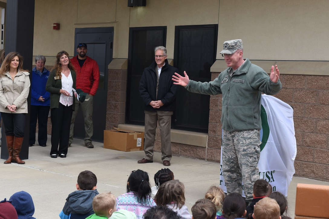 04262018-F-BM731-001 Col. Troy L. Endicott, 460th Space Wing commander, speaks to a group of children from Buckley Air Force Base Child Development Center about the importance of trees during an Arbor Day tree planting ceremony April 26, 2018 on Buckley Air Force Base, Colorado. (U.S. Air Force Photo by Senior Airman Jessica B. Kind)