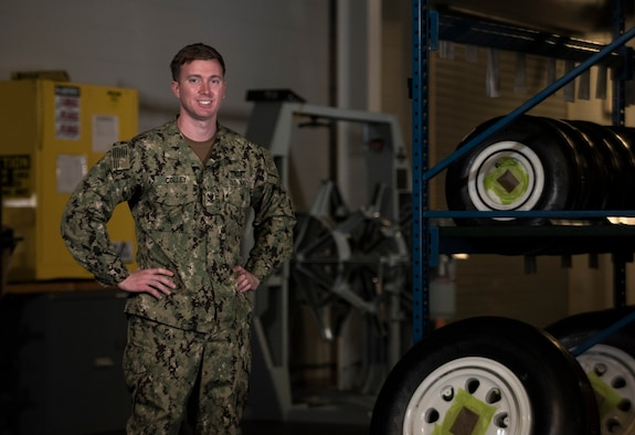 U.S. Navy Petty Officer 2nd Class Kyle Colley, 33rd Maintenance Squadron aviation structural mechanic, stands in his work center April 3, 2018, at Eglin Air Force Base, Fla. When Colley arrived in Florida, he didn't realize he would be assigned with an Air Force unit. He adapted quickly to the new environment and plans to use what he learned during his integration throughout the rest his career. (U.S. Air Force photo by Staff Sgt. Peter Thompson)