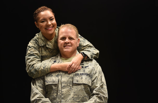 U.S. Air Force Airman 1st Class Alaina Marti, 81st Logistics Readiness Squadron ground transportation dispatcher, and her father, Lt. Col. Jon Marti, 81st Diagnostic and Therapeutics Squadron diagnostic radiologist, pose for a photo at Keesler Air Force Base, Mississippi, April 17, 2018. Alaina decided to join the Air Force after growing up as a military child and seeing her dad serve his country. The Defense Department celebrates Month of the Military Child in April to honor children who grow up with parents in the U.S. military. (U.S. Air Force photo by Senior Airman Holly Mansfield)