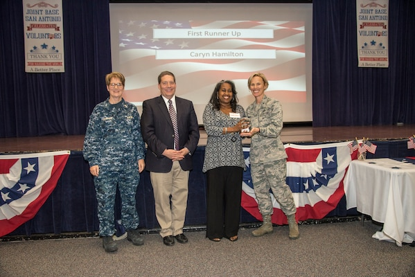 Celebrating the dedicated service of individuals and groups who have devoted their time helping members of the military community and remembering a beloved volunteer, Joint Base San Antonio held its annual Volunteer of the Year Awards Ceremony at the JBSA-Fort Sam Houston Military & Family Readiness Center April 18.