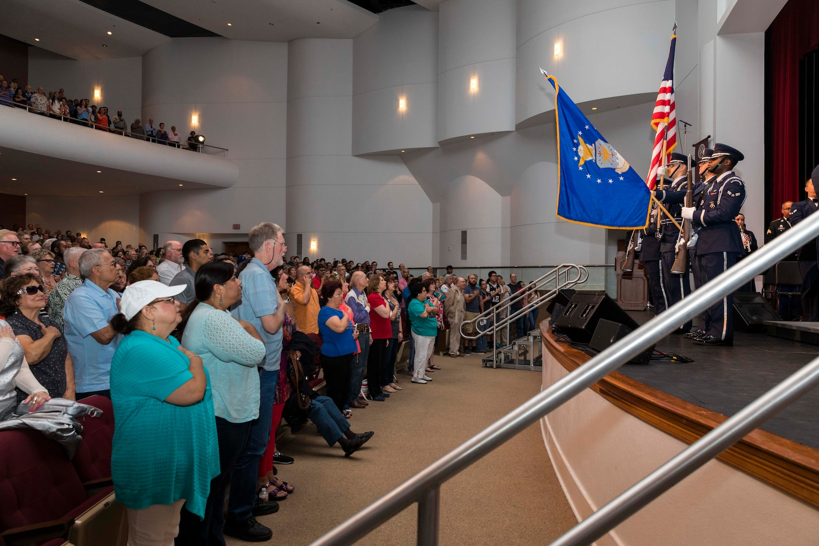 Civilians and military members render honors as the national anthem is played prior the Band of the West performance in San Antonio, Texas April 24, 2018. The act was dedicated to the 300th Anniversary of San Antonio and honors the city's military heritage. Since 1891, Fiesta has grown into an annual celebration that includes civic and military observances, exhibits, sports, music and food representing the spirit, diversity and vitality of San Antonio. (U.S. Air Force photo by Ismael Ortega / Released)