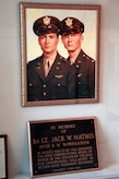 A painting of U.S. Army Air Corps. 1st Lt. Jack Mathis, 359 Bombardment Squadron, along with brother 1st Lt. Mark Mathis, 359 Bombardment Squadron, hangs in the San Angelo Regional Air Port terminal, also known as Mathis Field, in dedication to their service. Jack, a Medal of Honor recipient, was raised in San Angelo, Texas and trained at Goodfellow Air Force Base, Texas, and was honored for his services by having the Mathis Fitness Center on Goodfellow named after him.