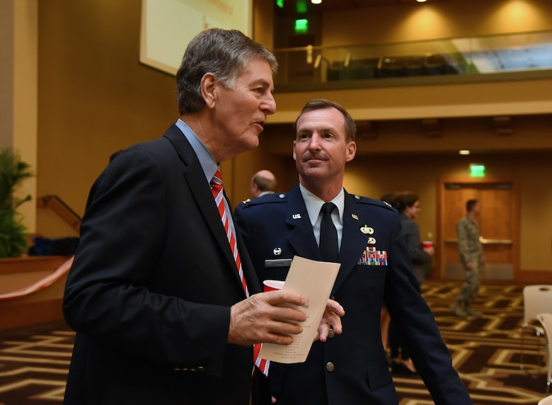 """Biloxi Mayor Andrew """"FoFo"""" Gilich speaks with U.S. Air Force Col. Chad Segura, 403rd Mission Support Group commander, during the 35th Annual City of Biloxi Volunteer Recognition Ceremony in the Biloxi Civic Center at Biloxi, Mississippi, April 24, 2018. The ceremony honored individuals and groups who volunteered time and energy to improve their communities. (U.S. Air Force photo by Kemberly Groue)"""