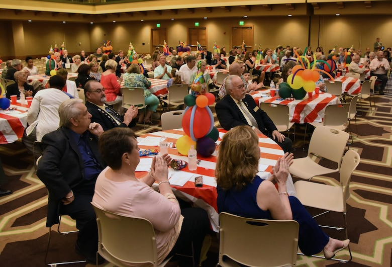 Attendees applaud during the national anthem while at the 35th Annual City of Biloxi Volunteer Recognition Ceremony in the Biloxi Civic Center at Biloxi, Mississippi, April 24, 2018. The ceremony honored individuals and groups who volunteered time and energy to improve their communities. (U.S. Air Force photo by Kemberly Groue)