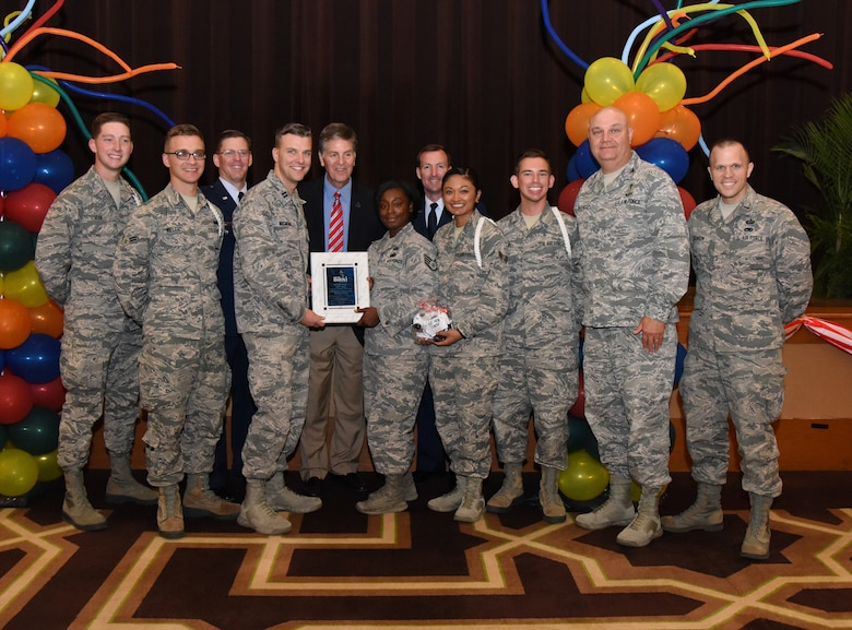 Members of the Keesler Air Force Base Fishbowl Student Ministry Center White Rope Program pose for a photo after accepting the Military Group Volunteer of the Year award during the 35th Annual City of Biloxi Volunteer Recognition Ceremony in the Biloxi Civic Center at Biloxi, Mississippi, April 24, 2018. The ceremony honored individuals and groups who volunteered time and energy to improve their communities. (U.S. Air Force photo by Kemberly Groue)