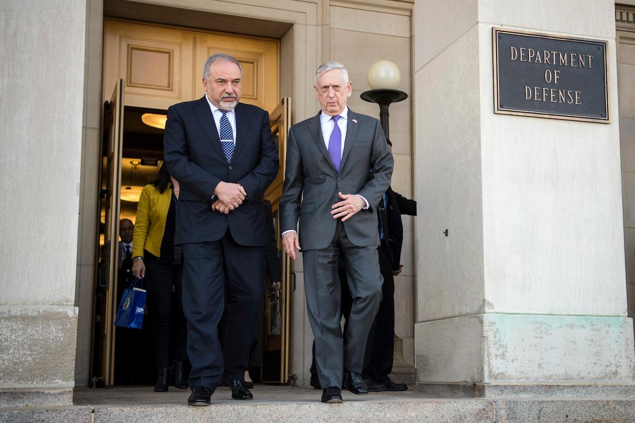 Defense Secretary James N. Mattis walks with Israeli Defense Minister Avigdor Lieberman outside a Pentagon entrance.